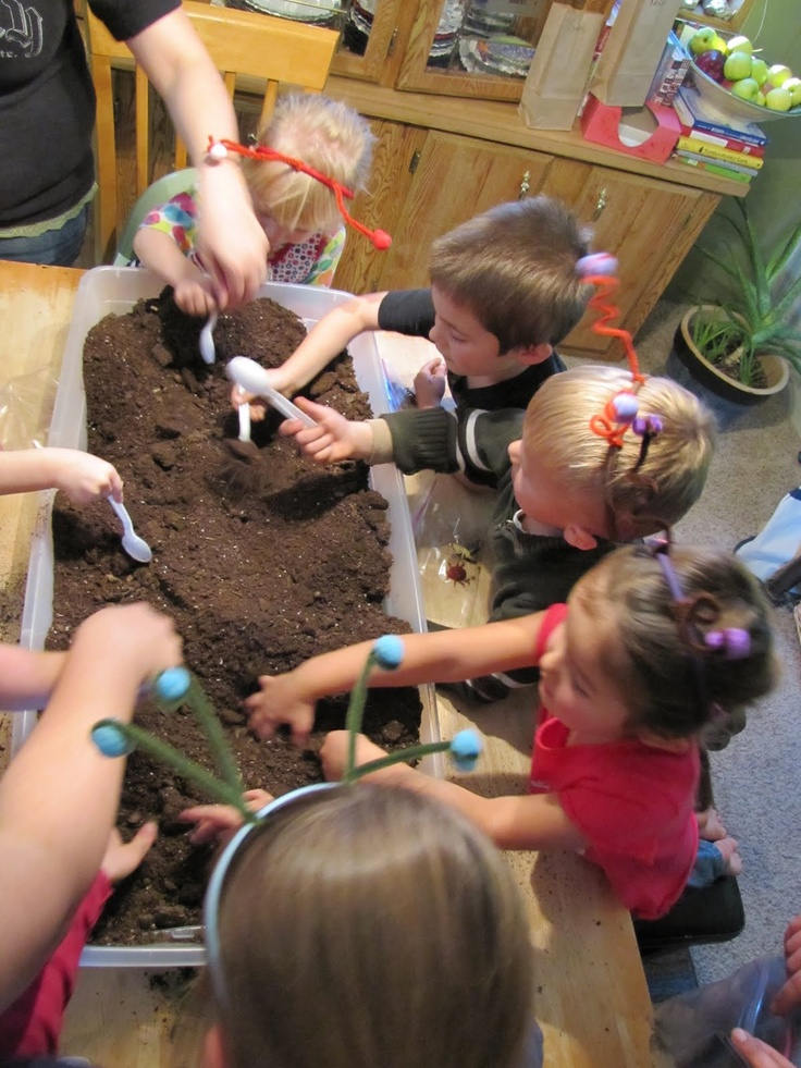 finding plastic bugs in the dirt - party activity