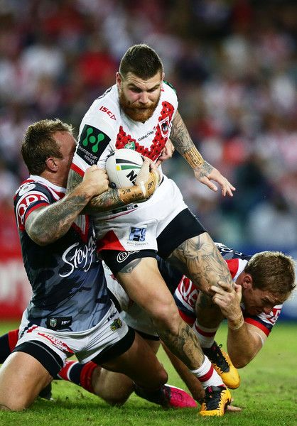 Josh Dugan Photos - Josh Dugan of the Dragons is tackled ball during the round eight NRL match between the St George Illawarra Dragons and the Sydney Roosters at Allianz Stadium on April 25, 2016 in Sydney, Australia. - NRL Rd 8 - Dragons v Roosters