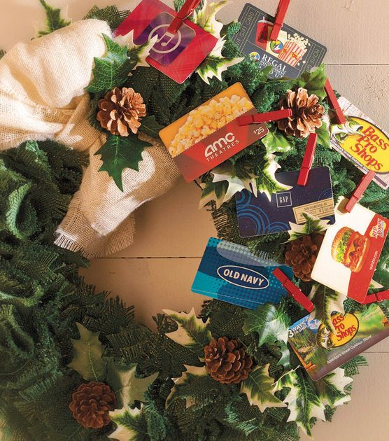 A cute way to display gift cards in a holiday wreath! #fabulouslyfestive: