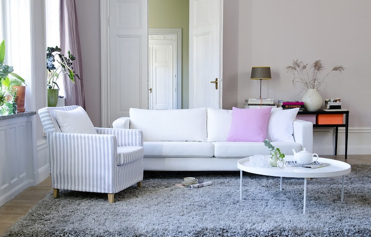 Classic white with a dash of light grey:   Karlstad sofa cover in Absolute White Panama Cotton, Karlstad armchair cover in Gotland Stripe - Silver Grey   and cushion covers in Candy Pink Panama Cotton and Absolute White Panama Cotton. All from Bemz. www.bemz.com
