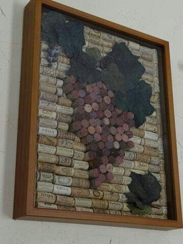 Looks like a fun project! Simply buy a 16x20 shadow box and some leaves from the local craft store, glue all the corks to the back of the frame and stick the leaves on!