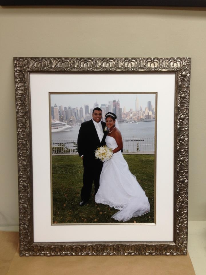 Wedding photo in a elegant silver moulding with a silver fillet and museum glass . Framed by Heba @ Tresorie Framing .