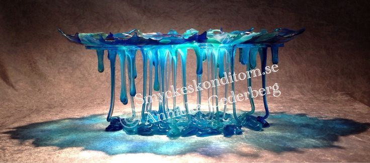This is my biggerst flowmelt and it has no inclusions, It's about 35 cm long, and 23 cm high. Glass art.