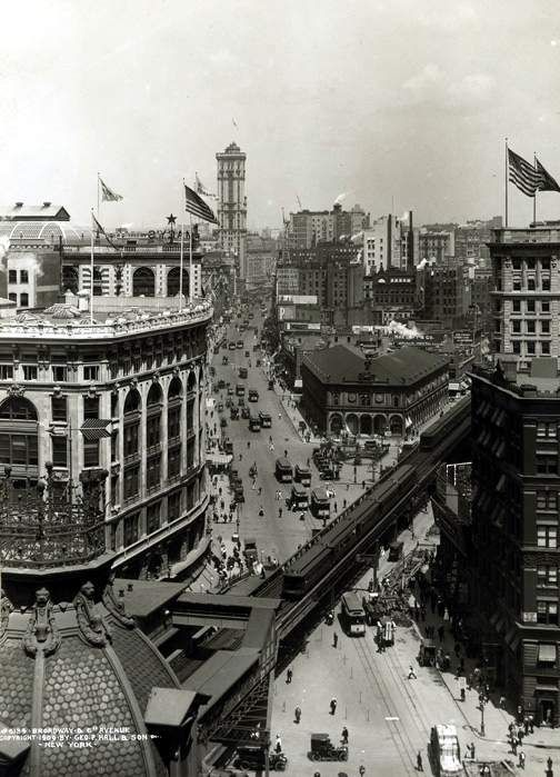 Herald Square, 1909. Skyscraper beyond is NY Times Building in Times Sq. Cars have replaced horses.