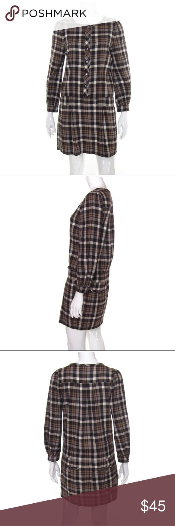 Juicy Couture Brown Plaid Flannel Shirt Dress Features long sleeves, a rounded neckline and a button front closure. Dropped waist features a tab button accent, functional tuck pockets at the hips/thighs. Back button closure pockets at the rear. Slight ruffling to the sleeves at the shoulder, very subtle, and functional buttons at the sleeve cuffs. Mini length, hits mid-thigh on most wearers. Material composition is 100% cotton, super soft flannel, lightweight and rigid/non-stretch. Tagged as…
