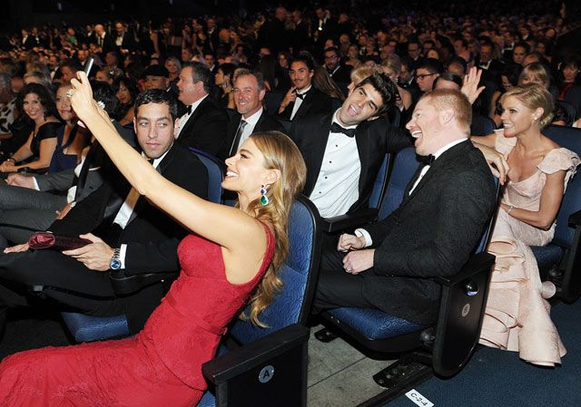 Modern Family's Sofia Vergara (with fiance Nick Loeb), Jesse Tyler Ferguson (with husband Justin Mikita) and Julie Bowen posed for an in-the-audience group selfie at the 2013 Emmys.