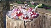 Summer, Tropical, tiki, Luau party, dress up a large bin or trash can to hold drinks