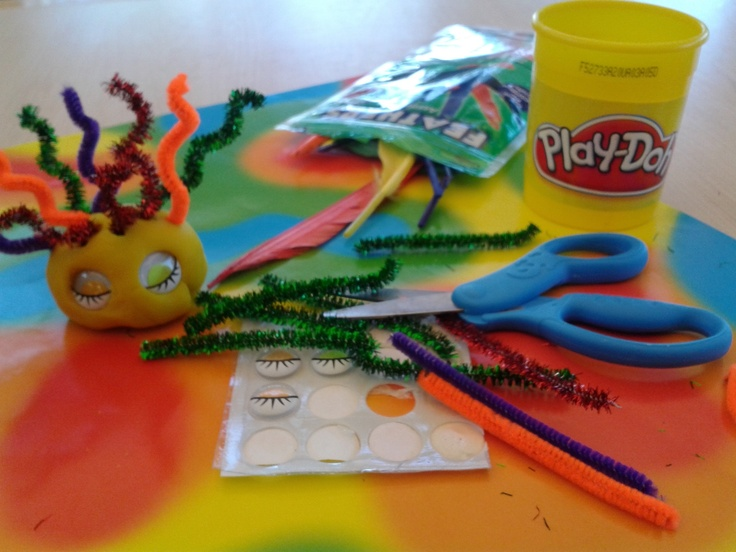For a quick and easy sensory and expressive arts activity for elders with Alzheimer's I grabbed some play-doh, pipe cleaners, googley eyes, and feathers and we put together some random objects.