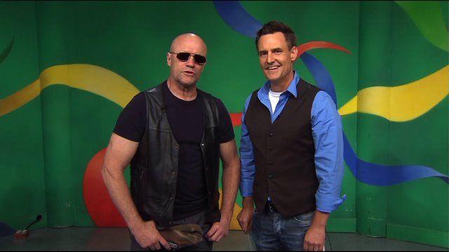 Michael Rooker 8/2014 -- newscaster's Merle impersonatioj