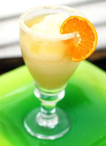 Italian MARGARITA:      6 ounces, fluid Frozen Limeade Concentrate      6 ounces, fluid Tequila      4 ounces, fluid Triple Sec      3 ounces, fluid Orange Juice      4 ounces, fluid Amaretto      1 Tablespoon Splenda      Ice, As Needed      _____      FOR RIMMING THE GLASS:      Amaretto      Sugar