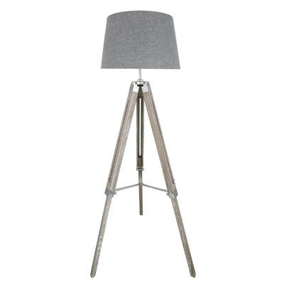Large marine tripod floor lamp base in a wooden and chrome finish. This contemporary lamp has been paired with a fabric drum shade to create a beautiful and stylish lamp.