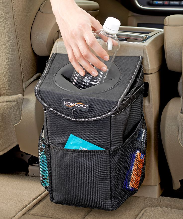 Keep gum wrappers and empty coffee cups off the car floor with this chic and convenient litter bag that's easy to empty and stow. The extra pockets ensure effortless organization.