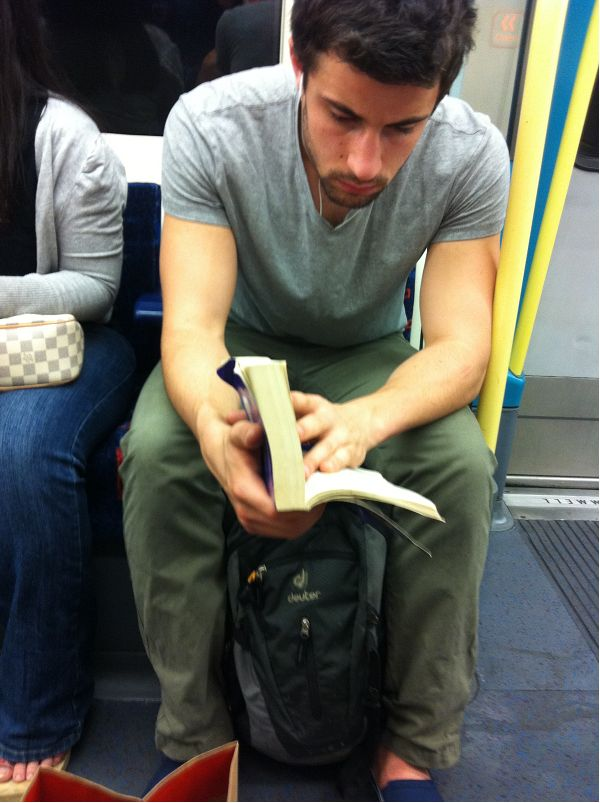 Random on the tube.    First tubecrush is hilarious. Reading, scruff, taking public transport ... awesome.