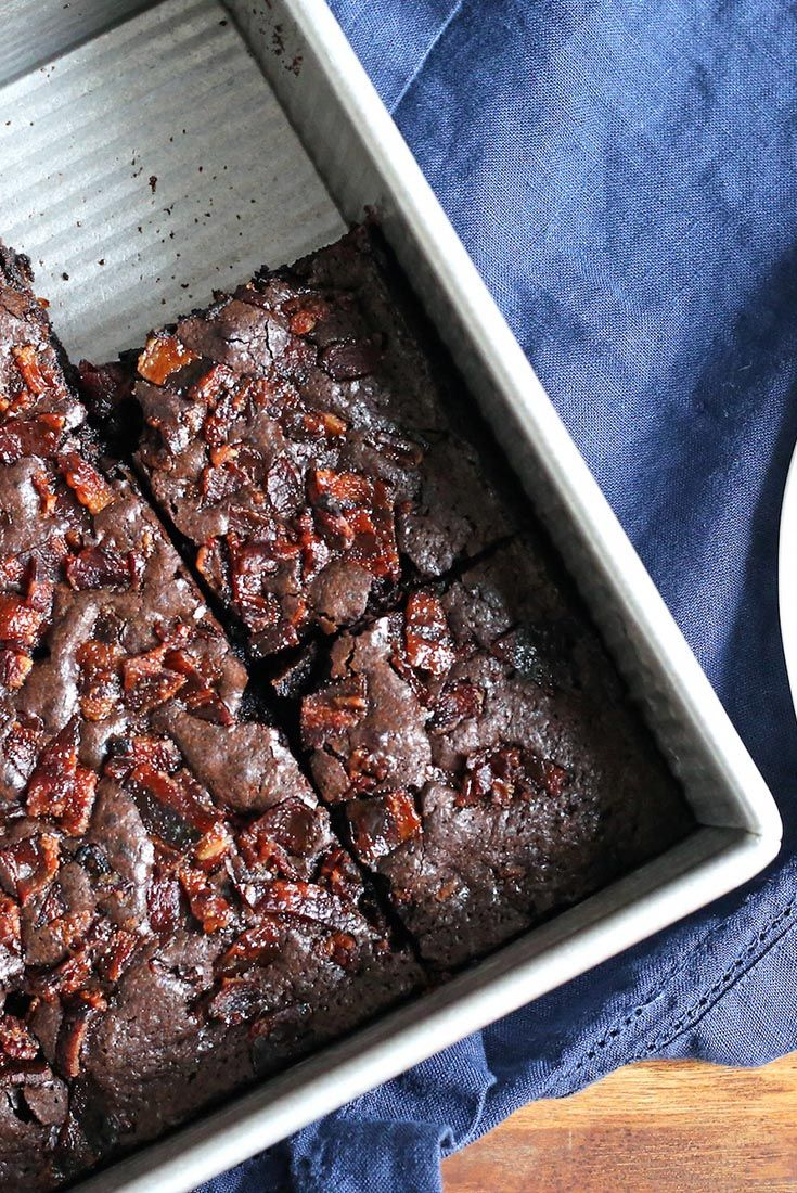 """Truly Decadent Bacon Brownies Recipe - Moist, dark fudge brownies with the smoky allure of crunchy bacon bits — what a tempting combination! Bacon, baked with brown sugar to """"candy"""" it, is sprinkled atop the brownie batter just before baking. The result? Salt, sweet, and smoke in each delicious bite. Our thanks to the folks at @applegatefarms for suggesting this recipe; we made these brownies with their Natural Sunday Bacon."""