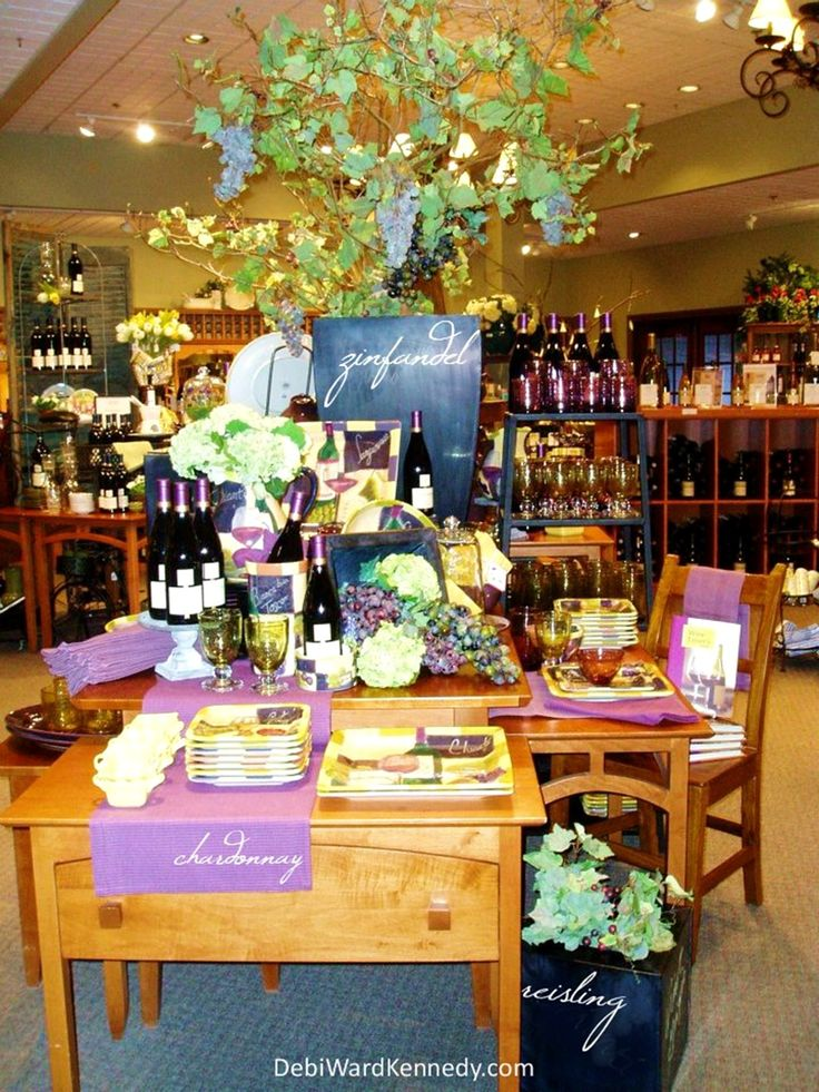Display Of Tabletop Goods Home Decor And Wine By Debi Ward Kennedy Appears ShopWindow DesignRetail DisplaysWindow IdeasGift