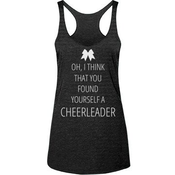 Cheerleader Lyrics Tank | Get this fun cheerleader lyrics parody tank top to show how much you love to cheer! Oh, I think that you found yourself a CHEERLEADER! She's always right there when I need her. Stunt with your squad while you listen to music and wear this trendy bow tank top.