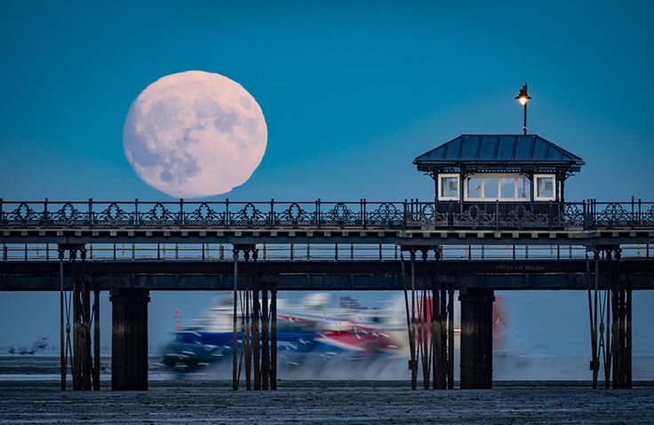 https://flic.kr/p/P9jr5v | Supermoon rising over Ryde pier on the Isle of Wight. | The 'supermoon' rising over Ryde pier on the Isle of Wight. Full details can be found here: Elm Studio    Click here to improve your photography ... on the Isle of Wight