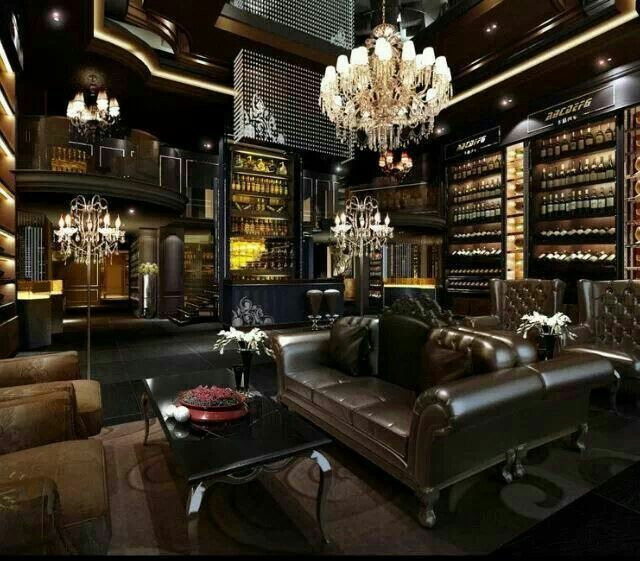 classy man cave with chandelier and leather couch