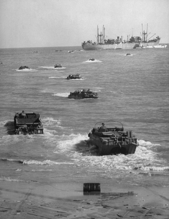 "Caption from LIFE. ""Amphibious trucks ferry supplies from cargo ship to Anzio beach. A few minutes before, a number of them had been sunk in attack by German fighter-bombers.""  Read more: Anzio: Rare and Classic World War II Photos From Italy 