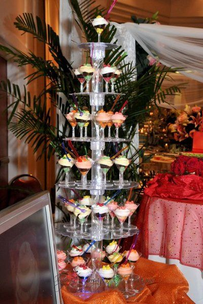 Martini Mini-Cupcake tower.  This was a hit at the show.  The clear acrylic stand was lit with mini white lights through the centre, with changing coloured lights at the base.  The mini martini cocktail glasses held jellybeane, cupcake topped with butercream frosting, more jellybeans and a cocktail fork.