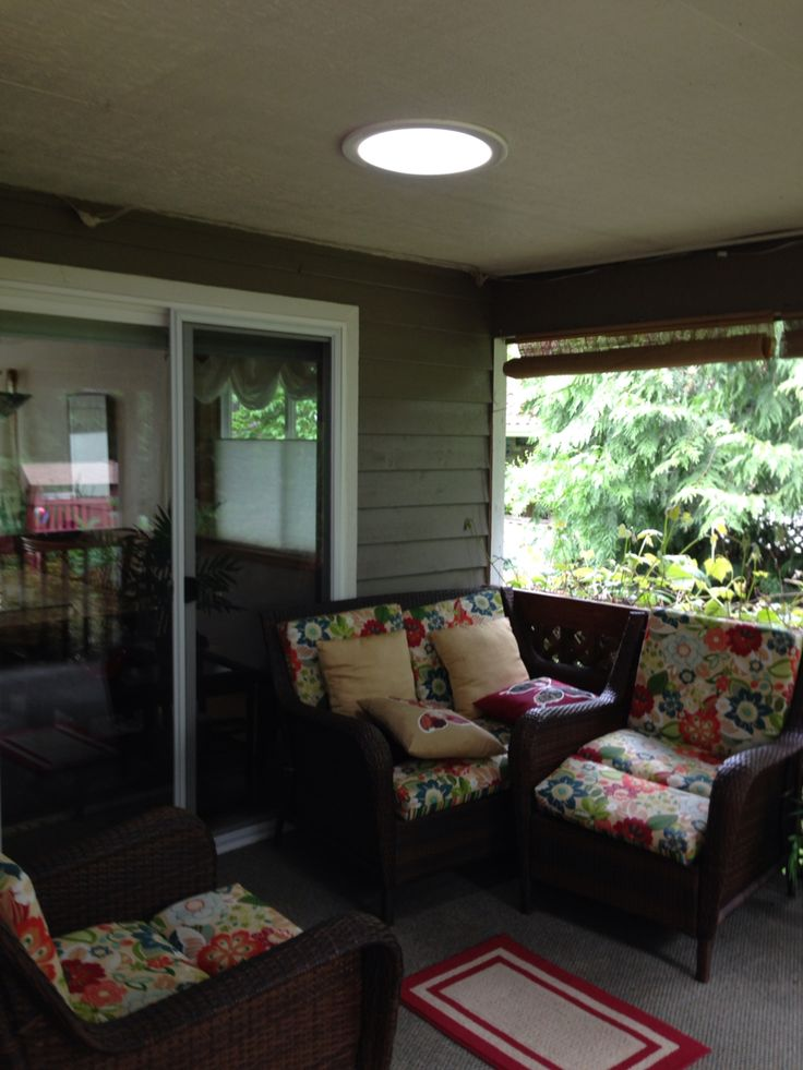 Put a Sola tube skylight in a covered porch to brighten the area.  This area was on the north side of the home surrounded by trees.  Before the skylight it was like sitting in a cave.   After the skylight it created a bright environment.