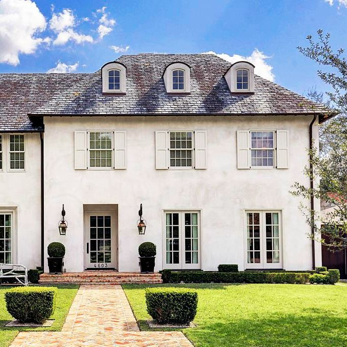 Stunning French Country stucco house with slate roof in Houston