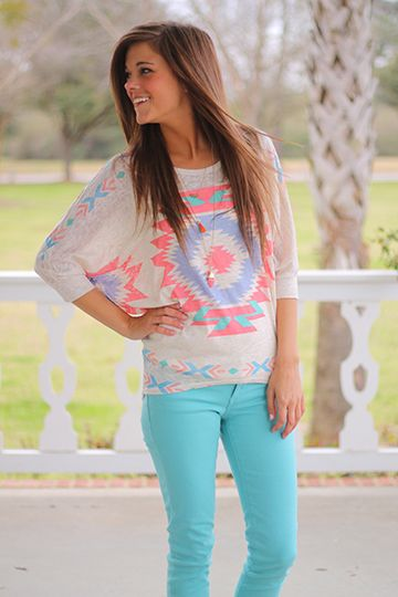 """This top is a can't miss item! We love the tribal patterns in pastel colors, and you know we are always a fan of dolman sleeves. Miranda paired this with colored skinnies, but denim would work, too! You really can't go wrong with this top!   Fits true to size. Miranda is wearing a small.  from shoulder to hem:  small-27""""  medium-28  large=29"""