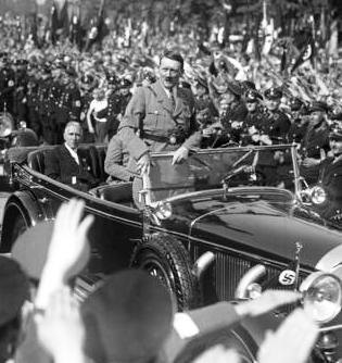 1933 with von Papen in the backseat. (via putschgirl)