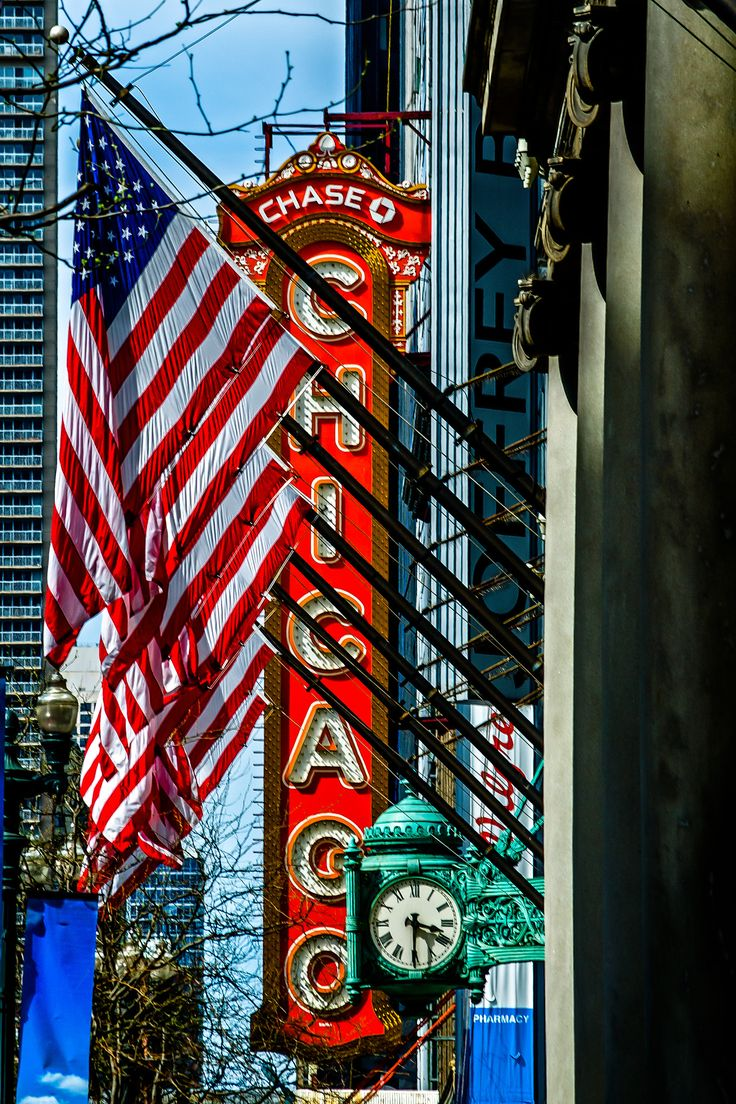 Classic Chicago - Chicago Theater, Marshall Fields clock and Old Glory. Pinned by #CarltonInnMidway - www.carltoninnmidway.com