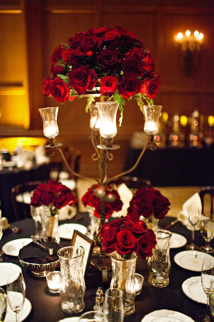 Dark red roses fill the table as they sit in vases and a candleabra capturing the theme of Phantom of the Opera | Jillian Ryan Photography | villasiena.cc