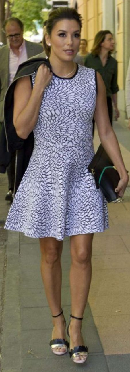 Who made  Eva Longoria's white print dress and black sandals?