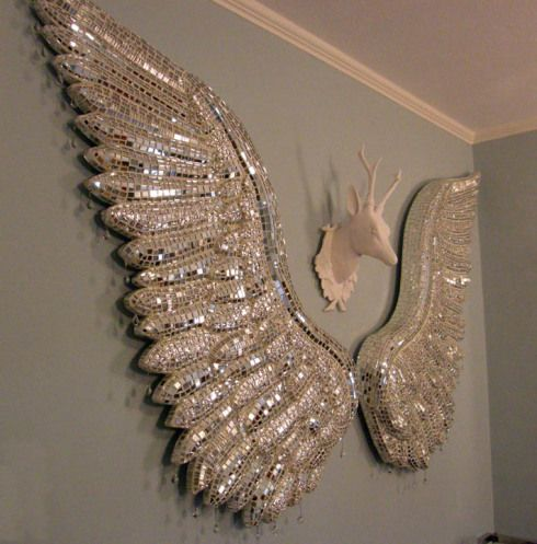 Project: Two large sculptural Silver Wings Dimensions: each wing approx. 42″L x 22″W Materials: Particle board, foam insulation, various mirrored glasses, glass rain drops, constructio…