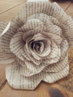 how to make this flower pull out, 6 pages from a book,and cut the petals. you need six of each size, like below, going from small to big next you need to curl the edges, i found it best to roll the edges around a thin stick then arrange then in piles by size, with …