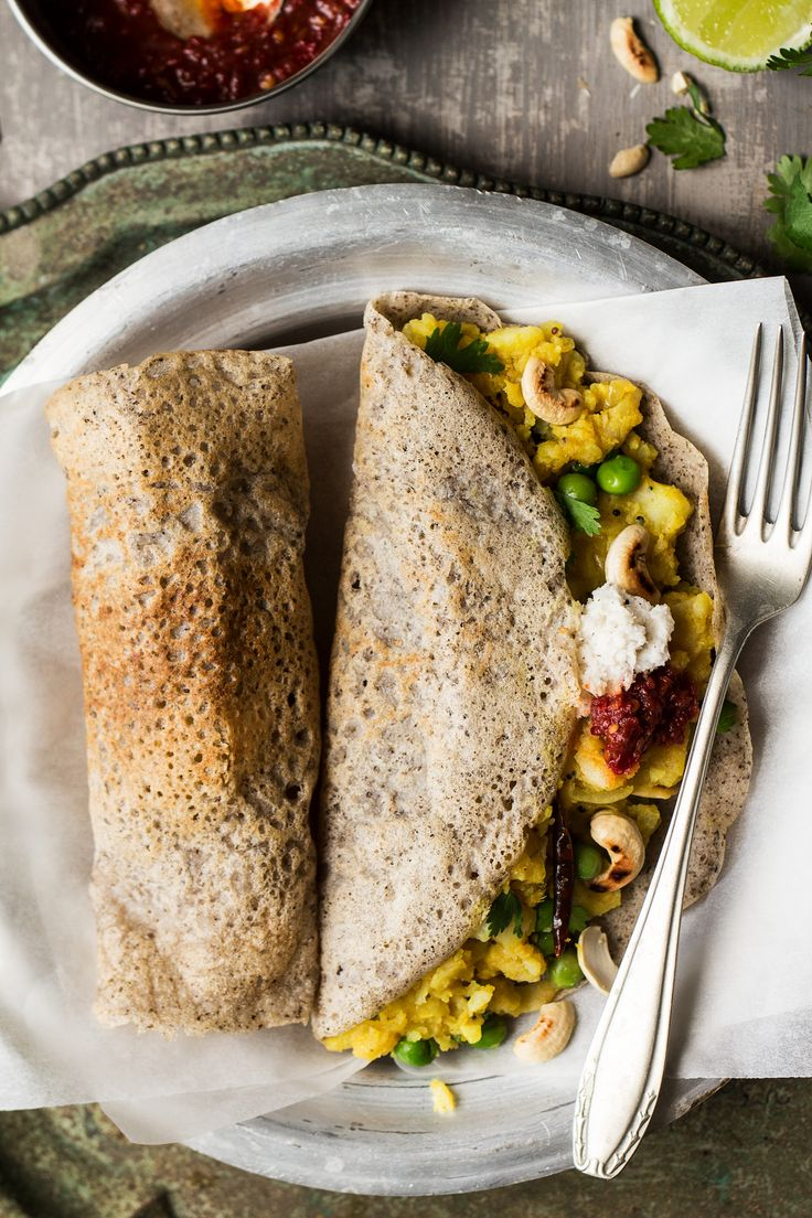 Vegan masala dosa is a crispy South Indian crepe filled with a spicy potato filling and topped with chilli sauce or coconut chutney. Naturally gluten-free.