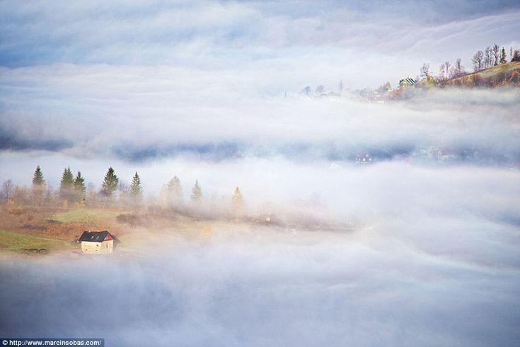 All but one house are hidden by thick mist in this valley in the Beskid Mountains...