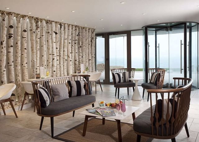 A grand hotel and cottages set on the headland overlooking Cornwall's Fistral Beach, with access to the award-winning spa and more