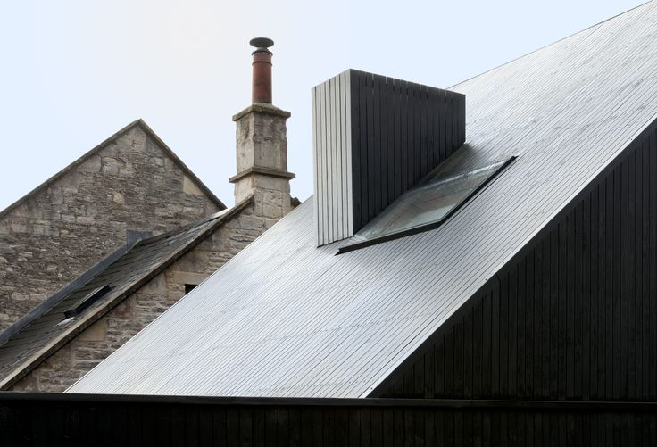Shadow House | Jonathan Tuckey Design, Wiltshire, UK- Cladded in the blackened western red cedar, the rear extension sits in the foreground of the existing Chapel.