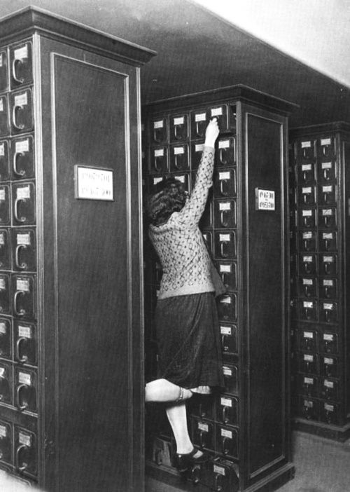 "Wow! That's a card catalog ... ""A librarian reaching for the top shelf of the card catalog."""