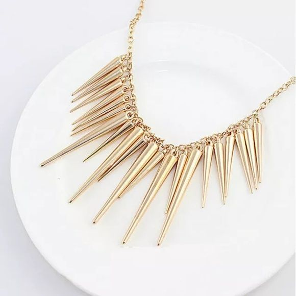 Gold Spike Necklace NWOT Gold spike necklace.                                               Also available in Silver                                               2 Available Jewelry Necklaces