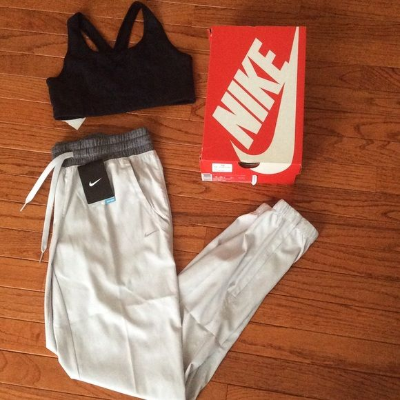 NIKE track pants and bra set- size XS  with tags- the track pants are Nike size XS and BONUS black sports bra (size small) for that Kylie Jenner look  Nike Pants Track Pants & Joggers