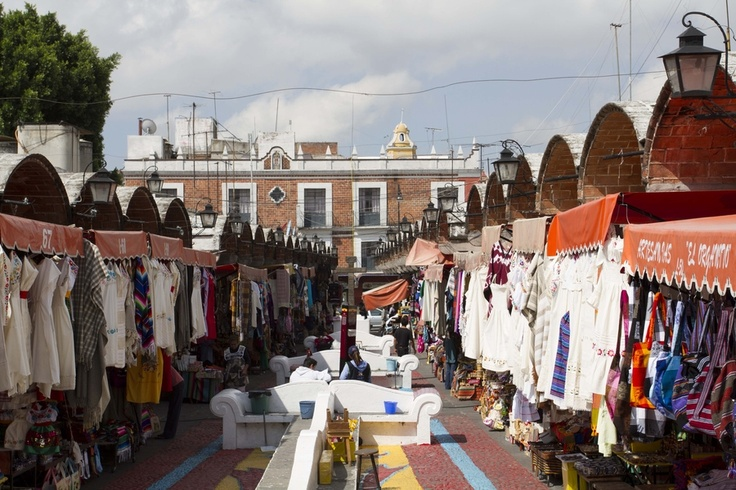 """In Puebla, there is a flea market called """"El Parian"""". You can bought food, arts, clothes & more. This is in Mexico. Photo by Joffre Monges"""