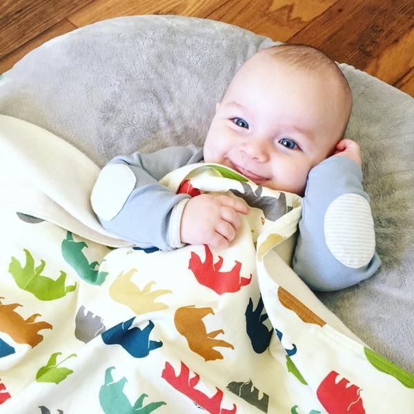 """This luxuriously soft organic baby blanket, available in a range of playful, modern prints, makes a unique and cherished gift for a new baby. Adorable without being too """"babyish"""" these prints are perf"""