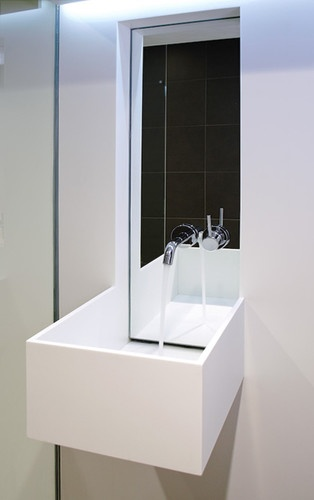 white corian and concrete bathroom modern bathroom