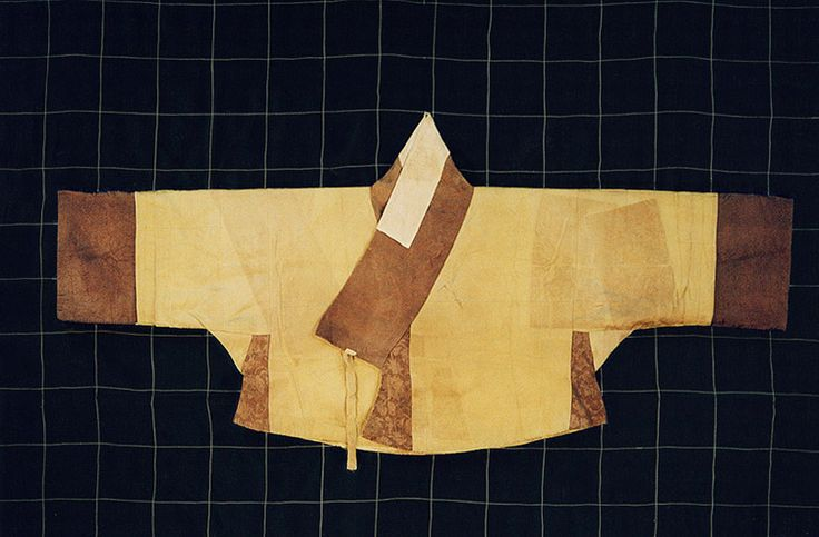 "Myeongjugyeopsamsujeogori/Silk lined jeogori/명주겹삼수저고리. Important Folklore Cultural Heritage  217-4. This jeogori is described as having the ""body and sleeves are light green and collar strip (for a Korean Jacket) is white."" It is associated with the daughter of Gim Cheom, from the  tomb of Gim Cheom of the Andong Kim clan, and his family. Late 16th/early 17th century."