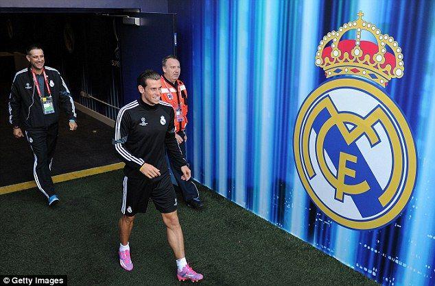 Local hero: Madrid's Welsh forward Gareth Bale at Cardiff City Stadium on Monday ahead of ...