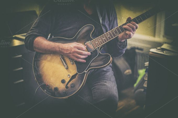 Check out Man playing guitar by Patricia Hofmeester on Creative Market