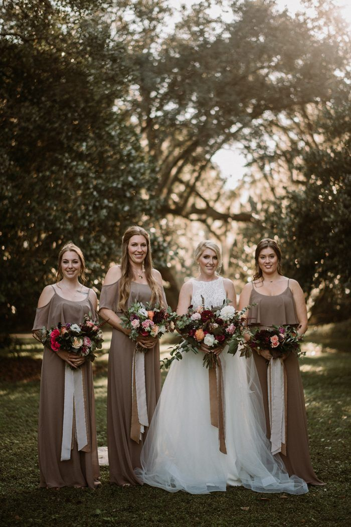e5982f53154 These elegant bridesmaids wore floor-length dresses in a dark taupe shade  at this fall wedding
