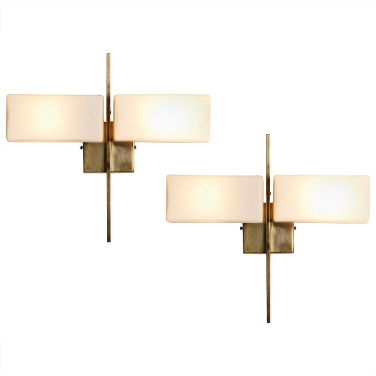 Italian pair of sconces with matt white glass and brass frame
