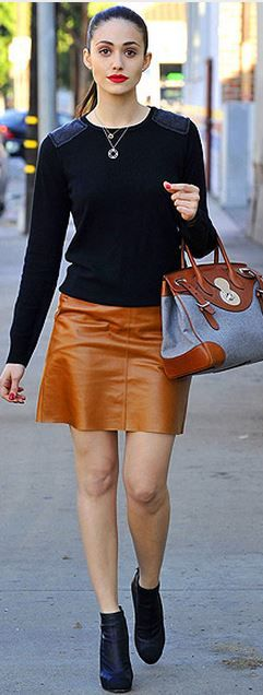 Who made Emmy Rossum's black sweater, tan leather skirt and two tone handbag?