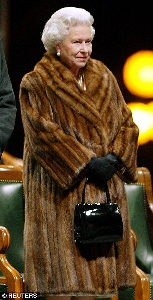 In fur (faux, you think? Nah...nothing like the real deal, I'm sure for the Queen) once again on her Golden Jubilee tour of Canada...